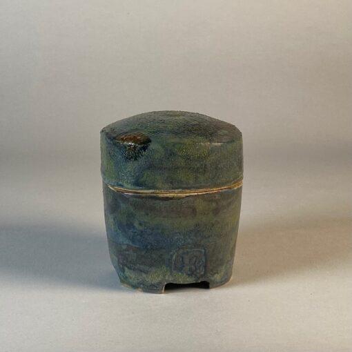 green lidded jar